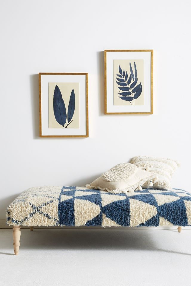 Large indigo blue kilm upholstered ottoman and blue fern wall art - Anthropologie. #bohostyle #indigoblue #interiordecor