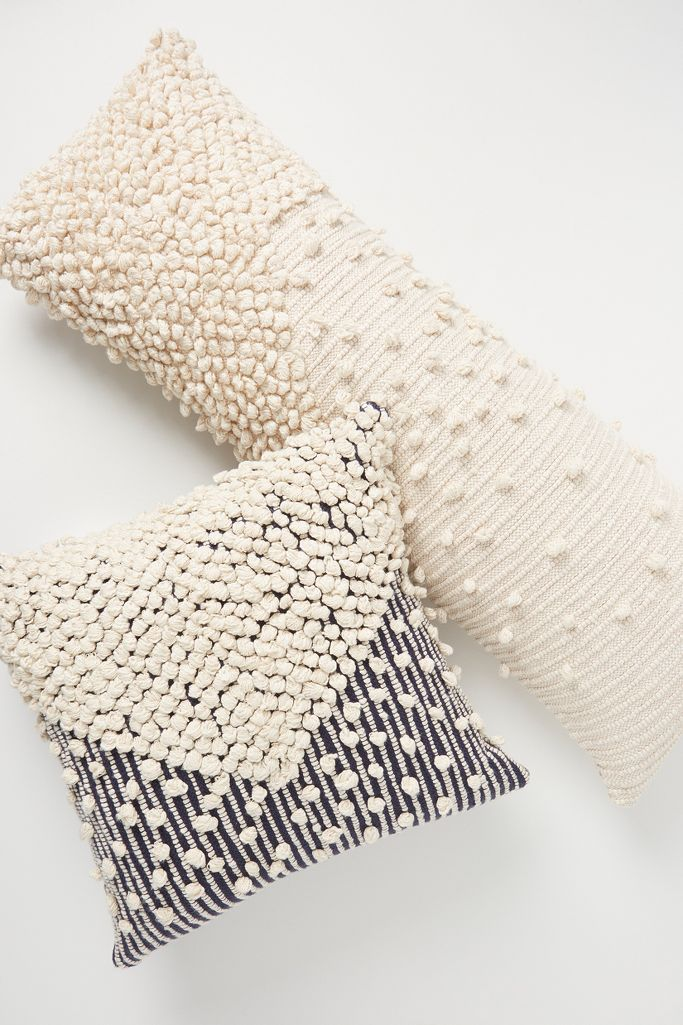 Textured Bobble throw pillows at Anthropologie bring a Moroccan flavor to a range of living room styles from French to Boho to Modern. #pillows #moroccanpillows #homedecor #nubbytexture #bohostyle #neutraldecor #livingroom