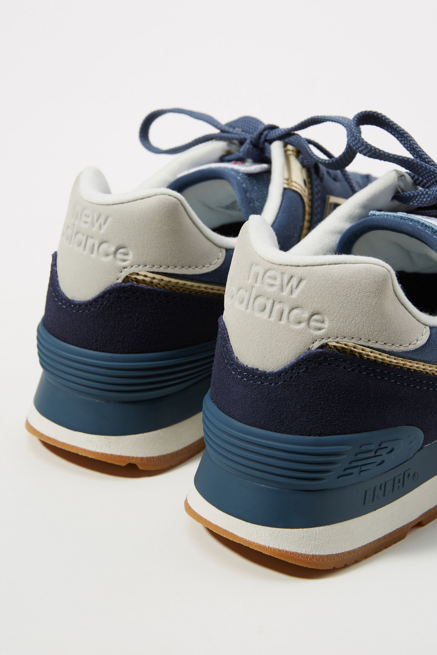 c13db33e79f New Balance 574 Sneakers