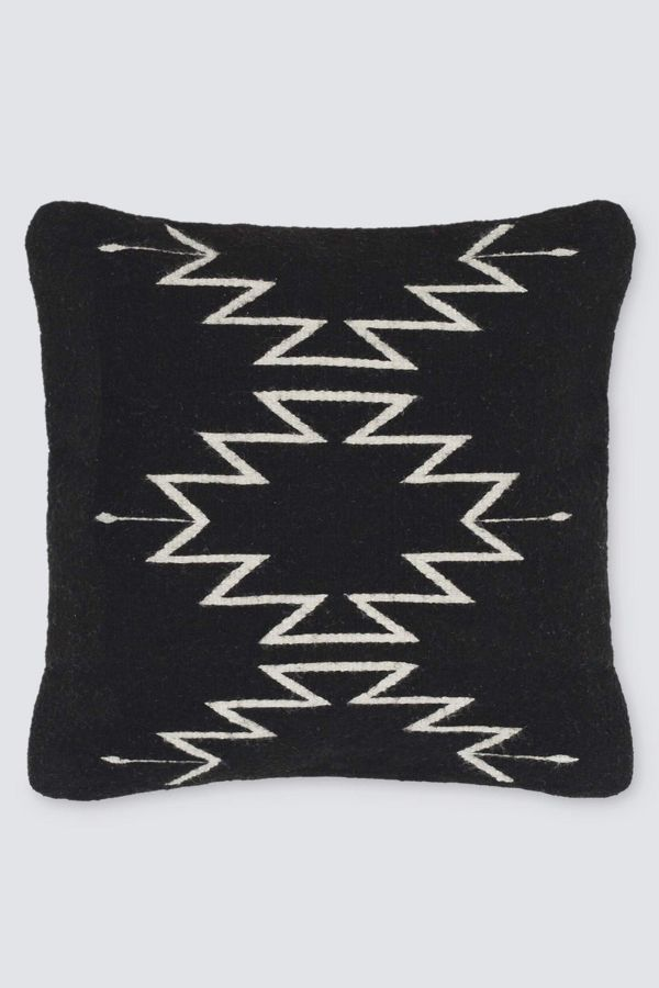 Inspired by Zapotec patterns from Mexico's Oaxaca region, the black and cream color combination brings a modern look to these native designs. This pillow is handwoven using sheep's wool from the local community. From start to finish, each one takes three days to complete! You'll love this Citizenry Tobala Pillow for boho artisan global style!