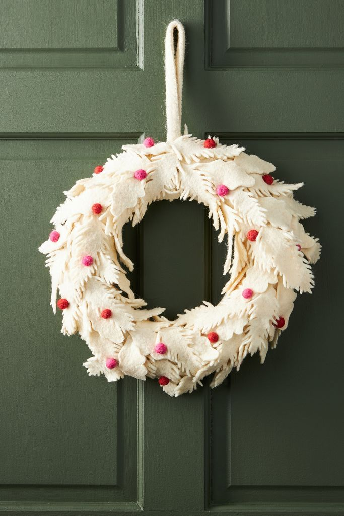 Berry Leaf Wreath with ivory felt leaves and pink and red berries - Anthropologie. #christmaswreath #shabbychic