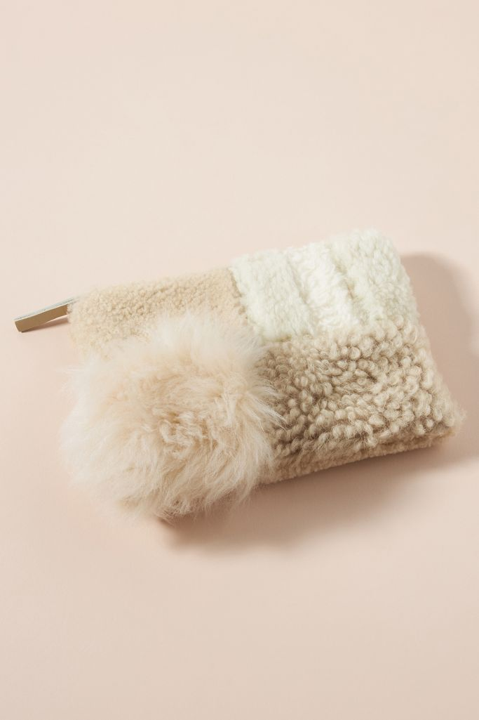 Patchwork shearling clutch - a cozy bag from Anthropologie.