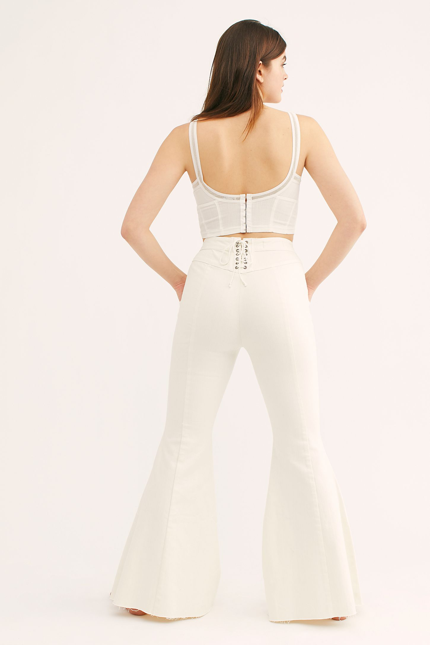 f2024efad46005 Slide View 3: CRVY Super High-Rise Lace-Up Flare Jeans