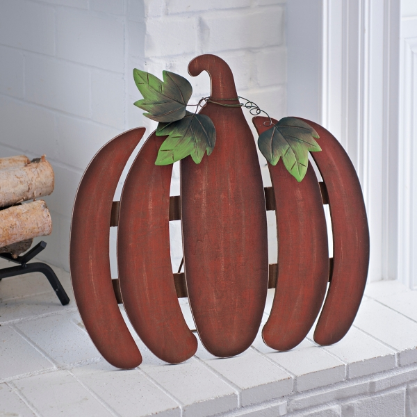 A group of wooden pumpkin plaques on the front step