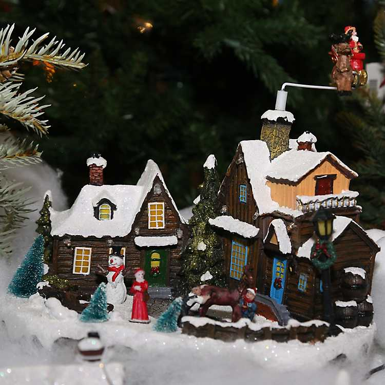 Lighted Moving Figures Christmas Village Statue | Kirklands