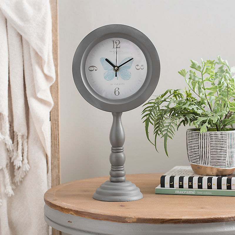 Gray Pedestal Butterfly Face Tabletop Clock