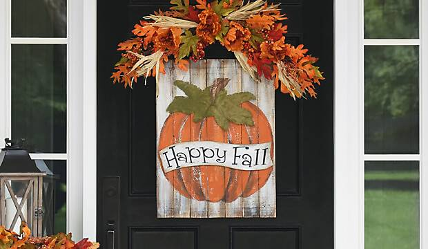 A front door decoratied for the fall season
