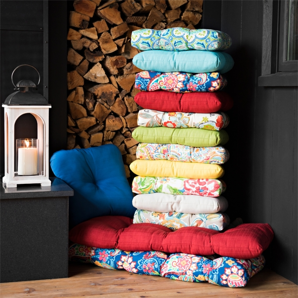 A variety of colorful outdoor chair cushions