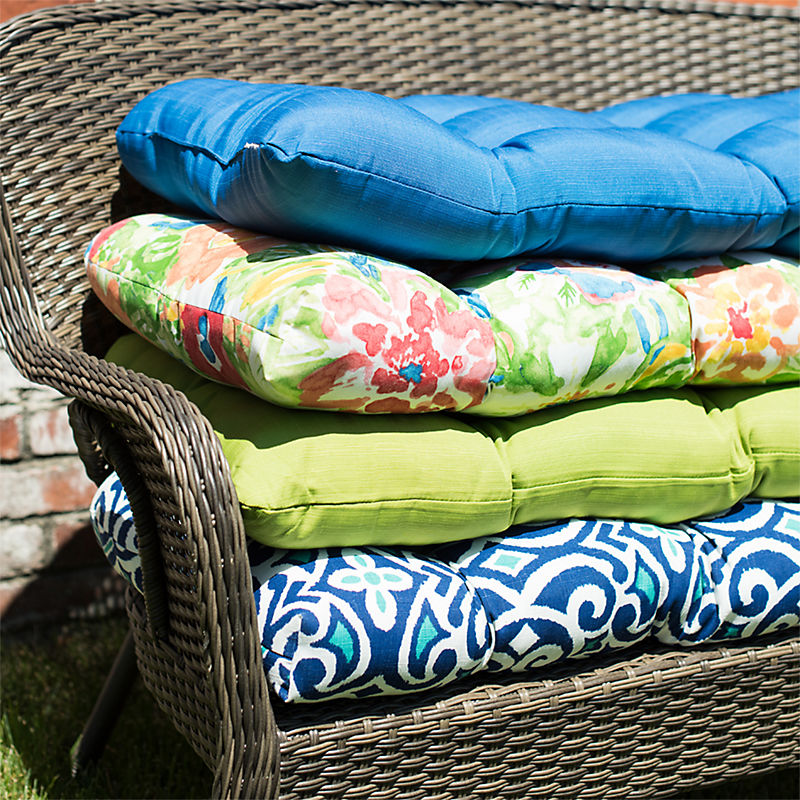 A selection of outdoor cushions and pillows in many colors and patterns