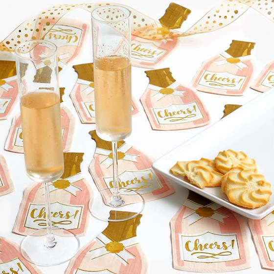 Die-cut champagne bottle paper cocktail napkins that read, Cheers!