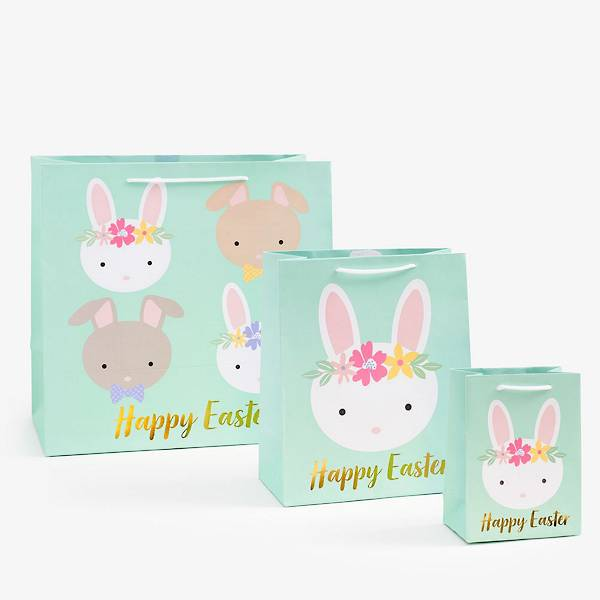 Happy Easter Bunny Gift Bags with a mint background, illustrated bunnies, and Happy Easter written in Gold Foil