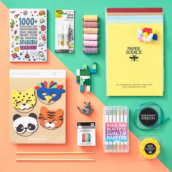 Contents of the make and play craft box, including Rainbow Washi Tape, Sticker Book, Cat Finger Puppet and Micro Cubebot