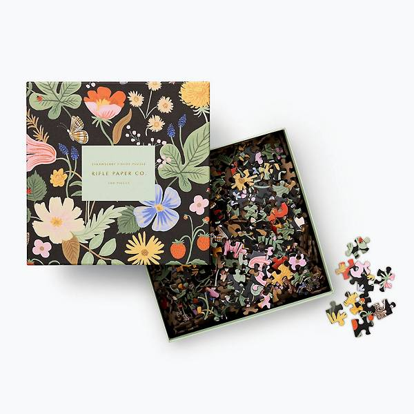 Butterflies flutter around beautiful blooms and sweet berries this beautiful 500 piece puzzle from Rifle Paper Co