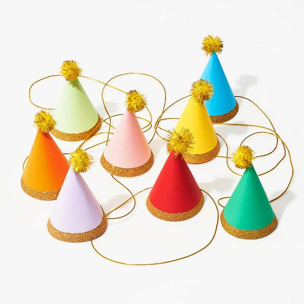 Colorful mini pom party hats.