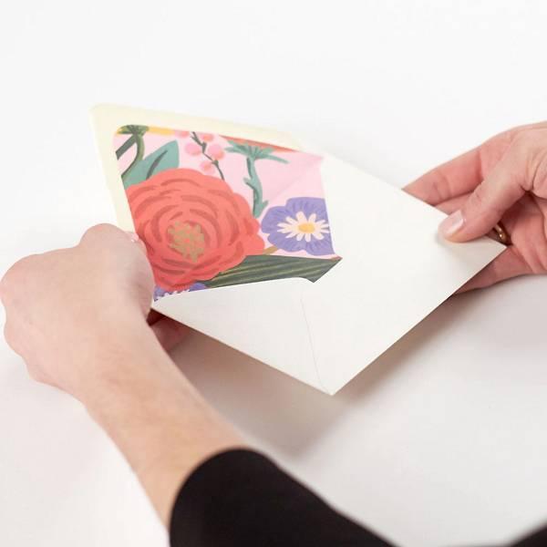 Woman creating a custom envelope liner.