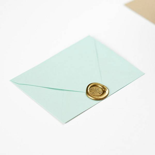 Wax seal displayed on a mint envelope.