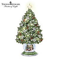 Thomas Kinkade Bringing Home The Tree Snowglobe Sculpture