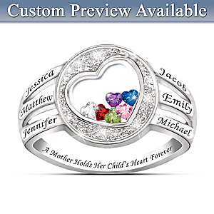 A Mother Holds Her Child's Heart Birthstone Ring With Names
