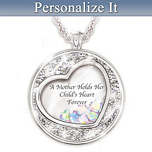 A Mother Holds Her Child's Heart Pendant Engraved With Names
