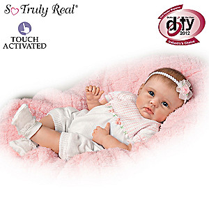 "Lifelike Interactive Baby Doll Really ""Holds"" Your Hand"