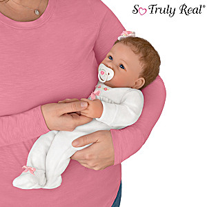 Lifelike Interactive Baby Doll Holds Your Hand