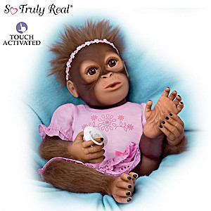 """Cooing Cora"" Touch-Activated Baby Monkey Doll"