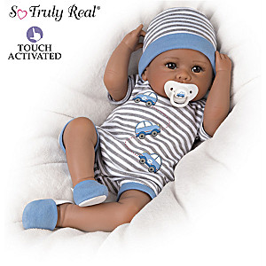 """Touch-Activated Baby Doll """"Coos"""" And Has A """"Heartbeat"""""""