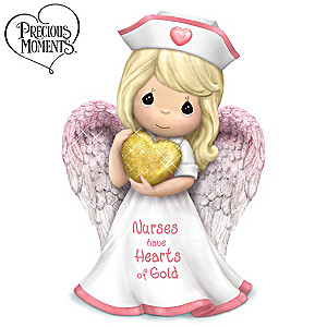 "Precious Moments ""Nurses Have Hearts Of Gold"" Figurine"