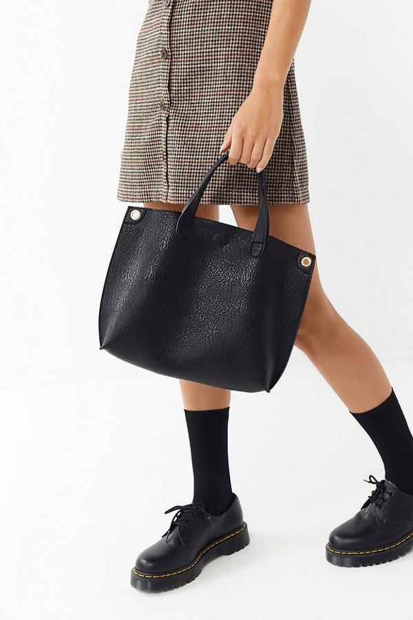 6988e00ba203a Your Urban Outfitters Gallery. Mini Reversible Faux Leather Tote Bag