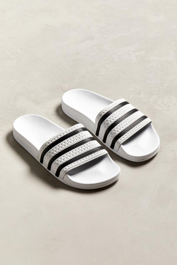 e3a2e8f024297 Slide View  1  adidas Adilette Core Slide Sandal