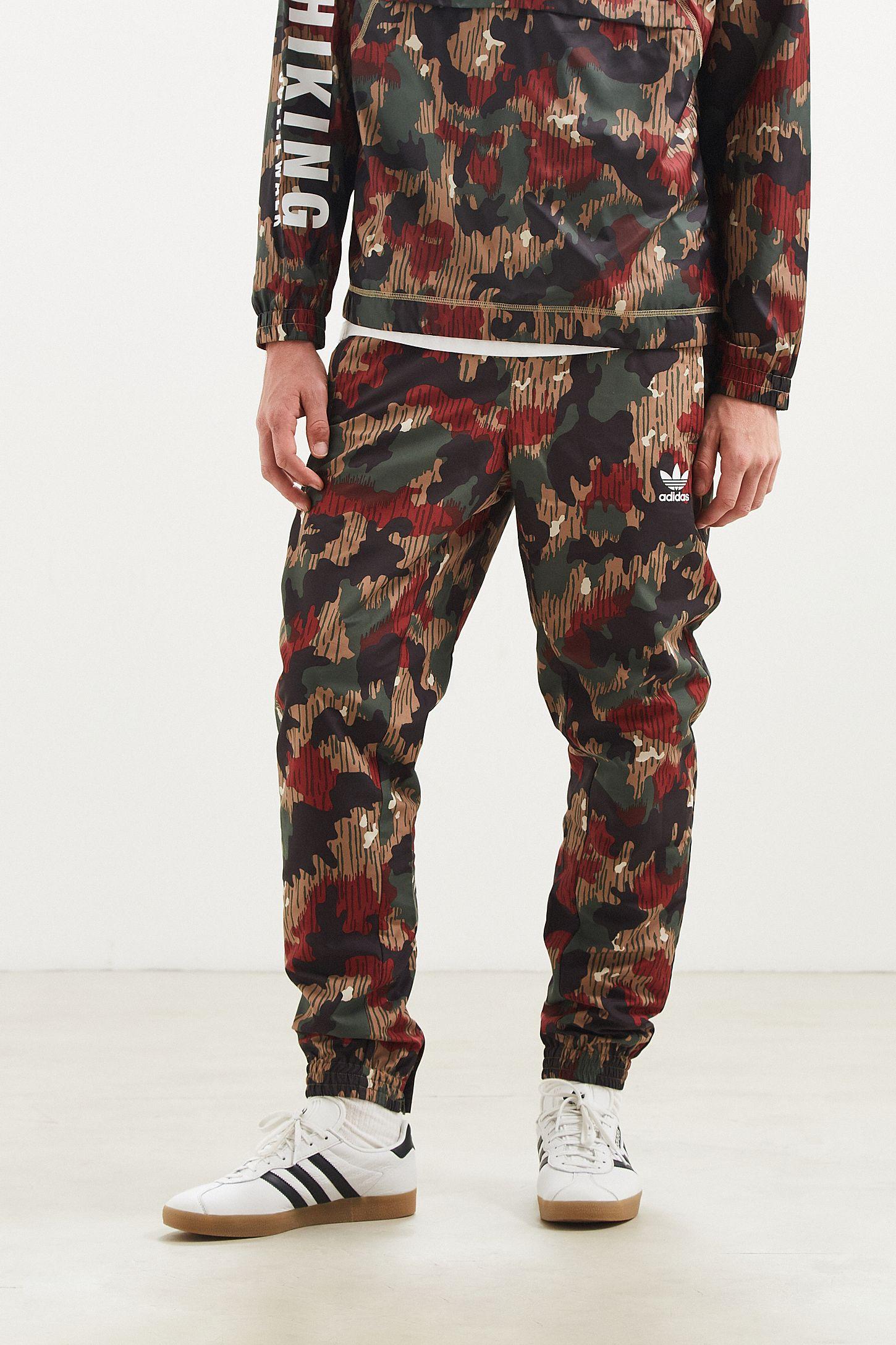 a034600c1 adidas X Pharrell Williams Hu Hiking Camo Wind Pant