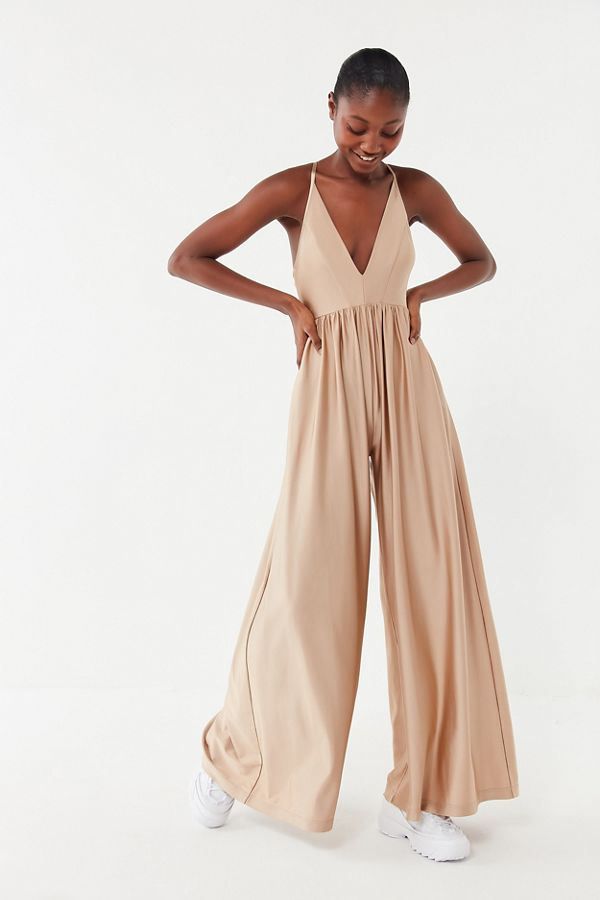 9d49cc1be61 Slide View  3  UO Gia Plunging Shimmer Jumpsuit