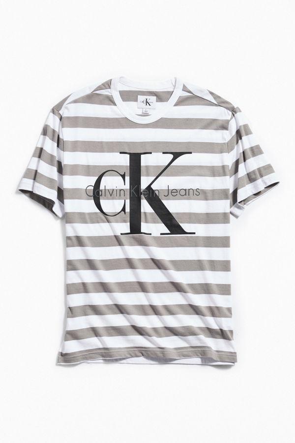 780b68adfcd1 Calvin Klein Logo Striped Tee | Urban Outfitters