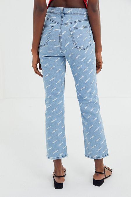 04688b5f258 Jeans évasé à taille haute et imprimé Lacoste