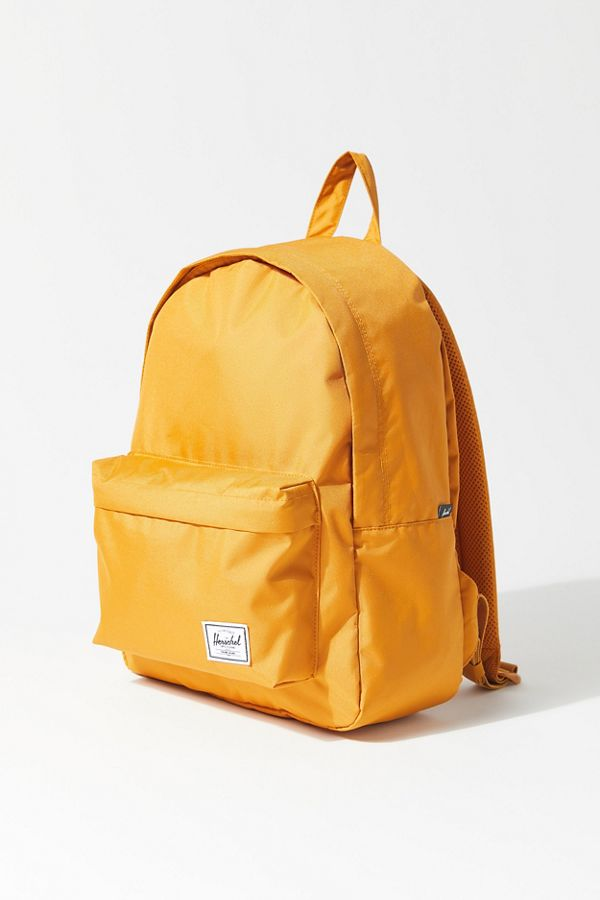 $11.99 (was $45)Herschel Supply Co. UO Exclusive Classic Mid-Volume Light Yellow Backpack