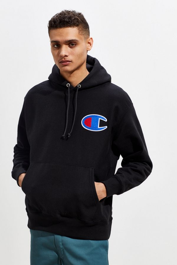 Champion hoodie featuring a Big C logo at the chest in a two-tone chain stitch applique for an elevated look. Classic pullover silhouette in a durable reverse weave cotton fleece features a soft brushed interior to keep you cozy. Complete with front kanga pocket