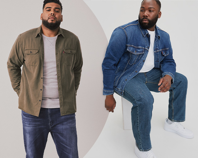 Man standing with green open button up with jeans and next to him is a man sitting wearing a denim jacket with jeans