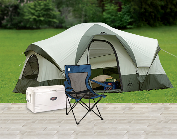 Camping gear - tents, sleeping bags, coolers and a chair.