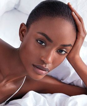 model wearing laura mercier flawless foundation