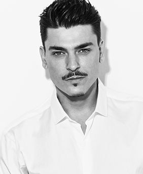 black and white headshot of brand ambassador mario dedivanovic