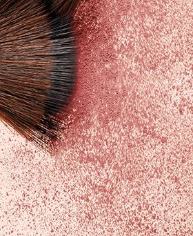 closeup of brush and shimmery blush