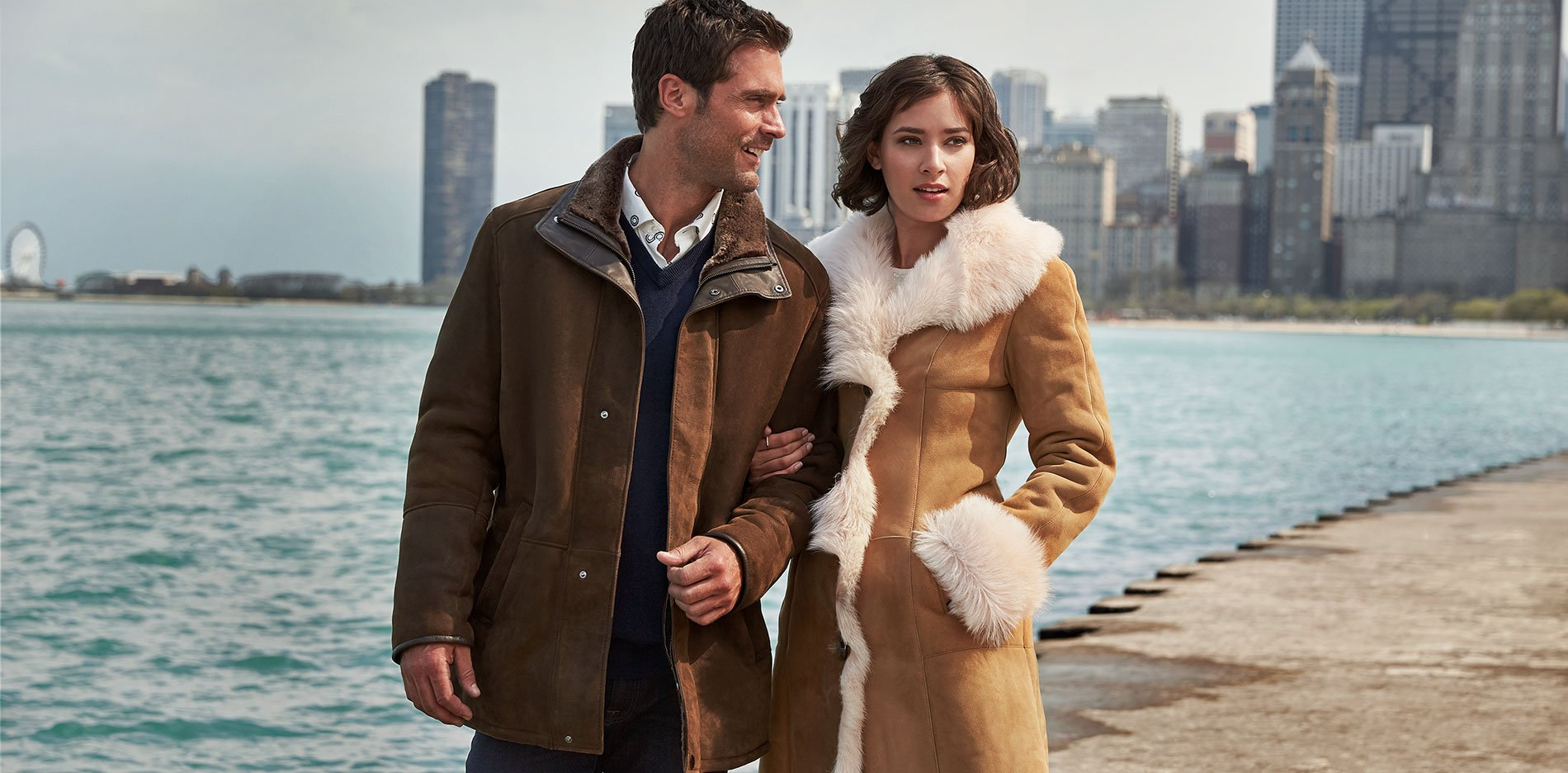 Couple wearing sheepskin coats